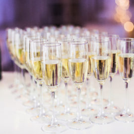Pouring champagne into champagne flutes on a celebration event